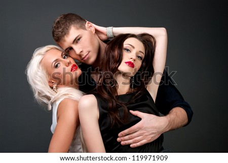 Relations between men and women love passion betrayal. Man and two women, blonde and brunette, love, sexy - the modern concept of love story for three people. Hatred between the two lovers.