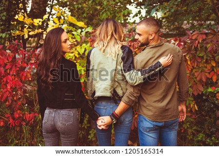 relationship concept tree people arguing  outdoor in park problems, secret behind back  #1205165314