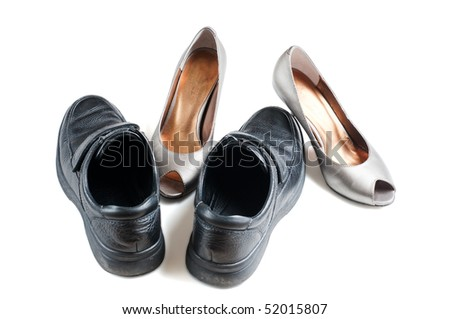 Relative place of men and women style shoes, seem to be two people hugging
