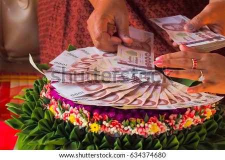 Shutterstock Relatives are counting dowry. The Dowry Marriage in Thai Culture. Objects for Thai Engagement or wedding.