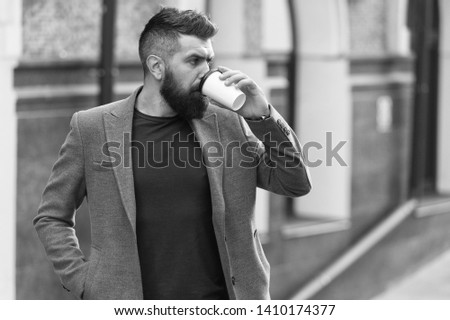 Relax and recharge. Man bearded hipster drinking coffee paper cup. One more sip of coffee. Drinking coffee on the go. Businessman lumbersexual appearance enjoy coffee break out of business center. #1410174377