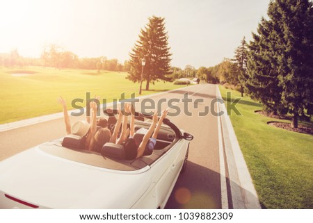Relax chill destination, auto vehicle rent, speed ride, students lifestyle. Festive joyful ladies and guy driver, chics girlfriends express vitality, emotions, success, euphoria, fly, hair, wind, sun