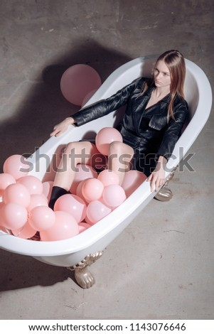 relax of woman in bath. relax of girl with balloons #1143076646