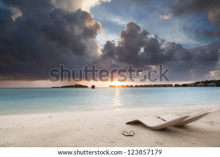 relax on beach at sunset