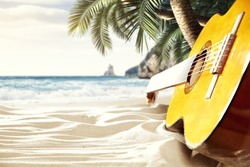 relax on the beach with a hot guitar