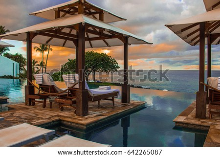 Relax on vacation at the pool area and which overlooks the  sunset in the beach and sea on a Maui Island  in Hawaii, USA. #642265087