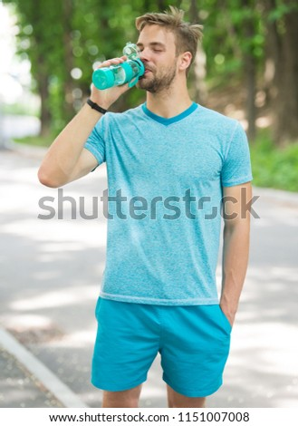 relax time. time to relax. relax time of healthy sportsman. athletic man has relax time in forest and drink water #1151007008