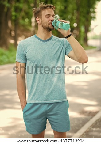 relax time. time to relax. relax time of healthy sportsman. athletic man has relax time in forest and drink water #1377713906
