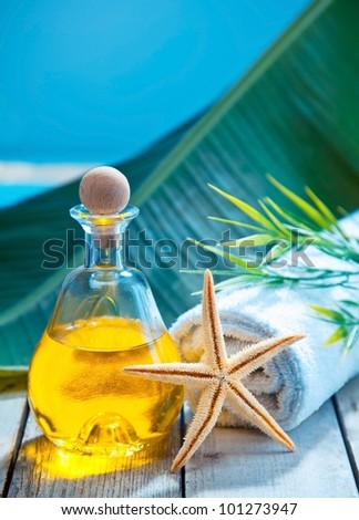 Relax with an essential oil aromatherapy treatment at a marine resort spa alongside a tropical ocean