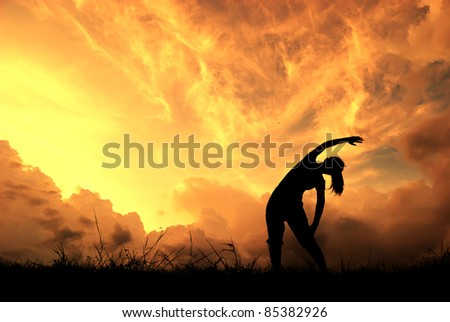 Relax yoga woman and sunset silhouette