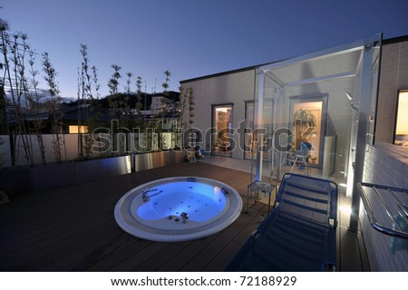relaxation in luxury bubble bath at night on blue