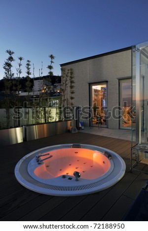 relaxation in luxury bubble bath at night on red