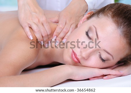 Relaxation in the spa salon for the pretty beautiful woman- close-up face