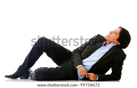 Relaxed businessman day dreaming - isolated over a white background
