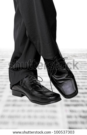 relaxed businessman on newspaper - stock photo