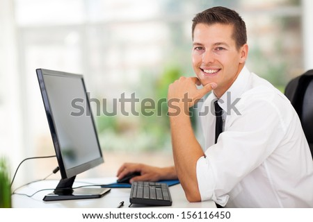 relaxed businessman sitting in modern office