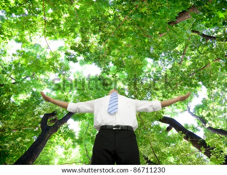 relaxed businessman stand in the forest