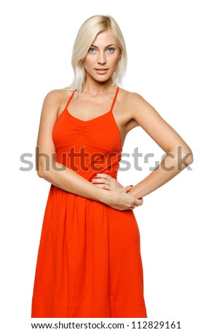 Relaxed casual young woman standing with hand on hip, over white background