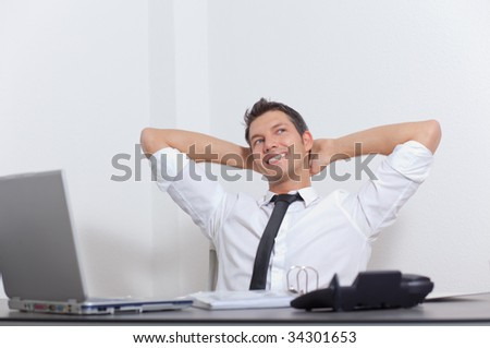 Relaxed cheerful smiling businessman enjoying success career