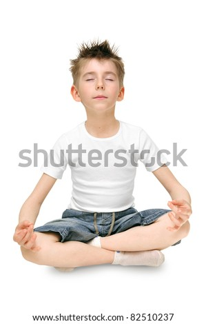 Relaxed child practicing yoga isolated on white background