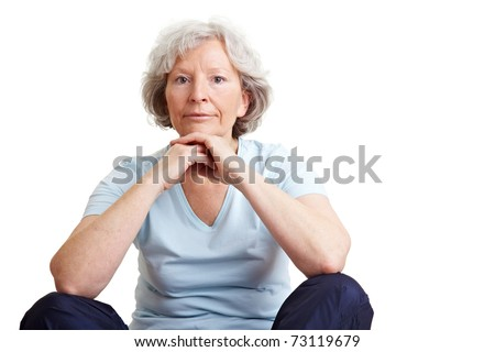 Relaxed elderly woman sitting in tailor seat on the floor