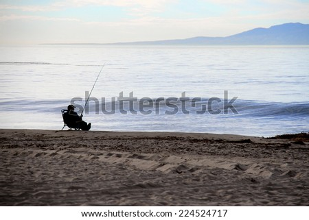 relaxed fisherman fishing on the ocean beach #224524717