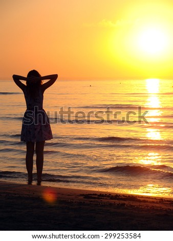 Relaxed girl looking at the sunrise