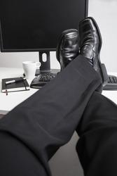 Relaxed leg of a business man
