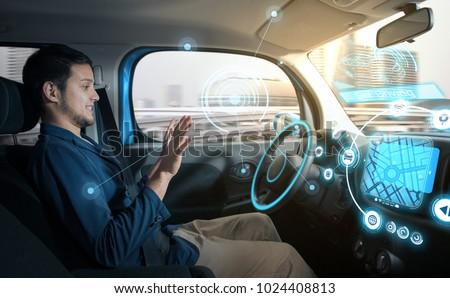 relaxed man in autonomous car. self driving vehicle. autopilot. automotive technology. #1024408813