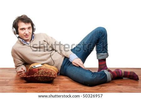 relaxed man listening to the music lying down