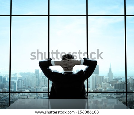 relaxed man sitting in office