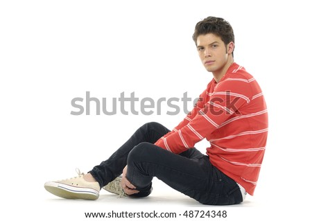 relaxed man sitting on the floor over white