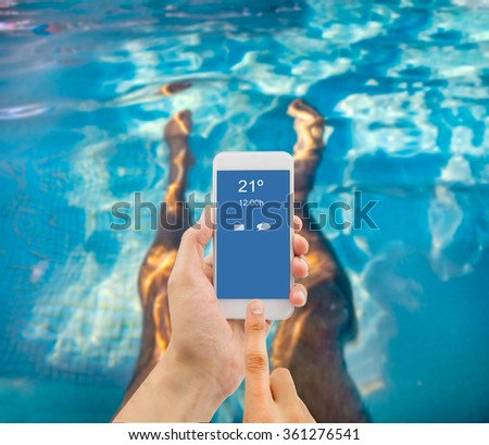 relaxed man using the smart phone in the pool of spa #361276541