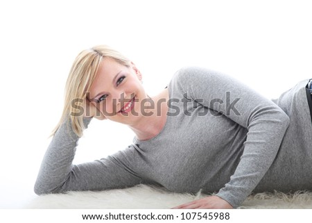 Relaxed smiling woman Relaxed smiling woman lying on white background