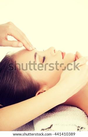 Relaxed woman enjoy receiving face massage #441410389