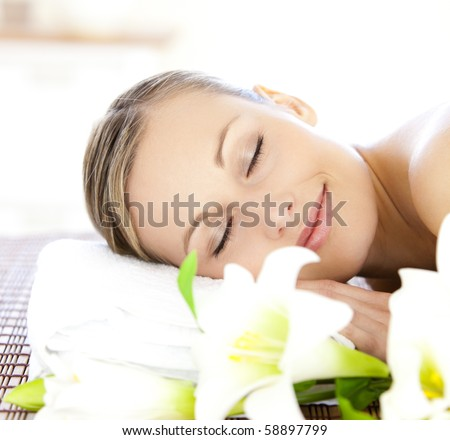 Relaxed woman lying on a massage table in a spa center