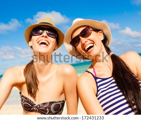 Relaxed young friends having fun on the beach