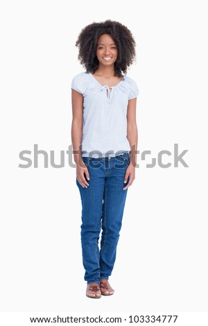 young woman standing up with arms by side against a white backgroundWoman Standing Side White Background