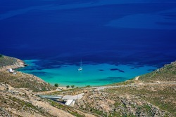 Relaxing anchored on turquoise clear waters in Psili Ammos, Serifos island Cyclades Greece