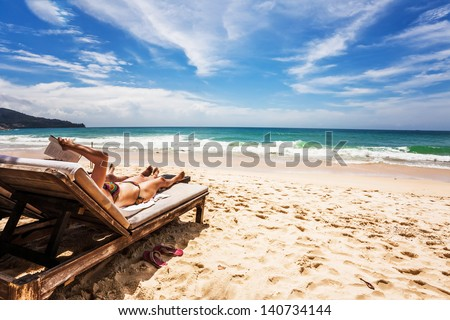 Relaxing and reading on the beach. Thailand