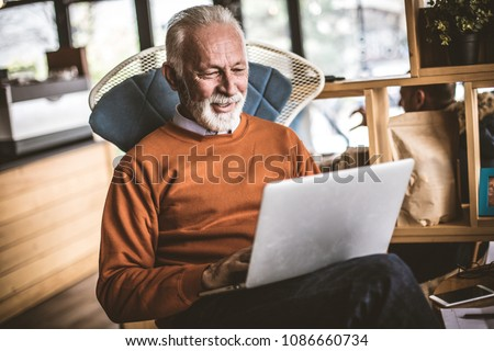 Relaxing and working at home. Senior businessman.  Stockfoto ©