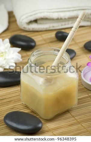 relaxing aroma of almond coconut vanilla milk and honey bath foam over wooden mat