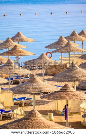 Relaxing at paradise beach - Chaise lounge and parasols - travel destination Hurghada, Egypt Foto stock ©