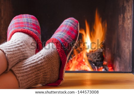 relaxing at the fireplace on winter evening