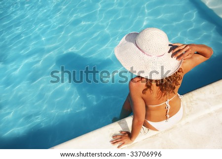 Relaxing at the pool,  similar available in my portfolio