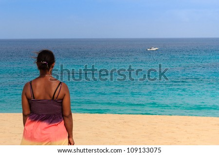 relaxing beach womanlook at a boat