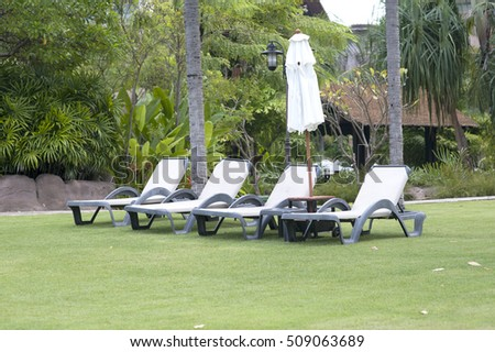 Relaxing chairs beside of swimming pool