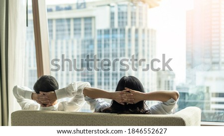Relaxing couple lifestyle take it easy, lazy resting happily living in luxury city condominium, urban condo apartment, or business hotel tower for life-work balance and life quality concept ストックフォト ©