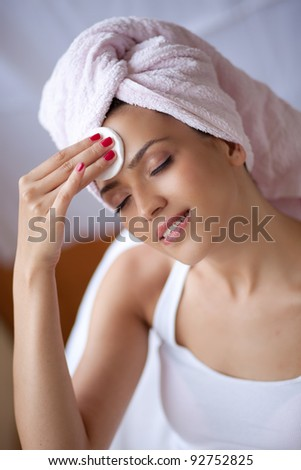 Relaxing during a facial steam treatment at a beauty spa.