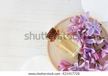 Relaxing essential oil, fresh flowers, relaxation setting, top view.